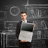 Businessman with open laptop in his hands Royalty Free Stock Images