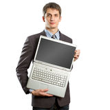 Businessman with open laptop in his hands. Smiles at camera Royalty Free Stock Photos