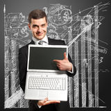 Businessman With Open Laptop In His Hands. Smiles at camera Stock Photo