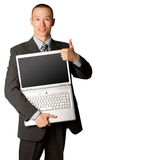 Businessman with open laptop shows welldone. Businessman in expensive suit with open laptop shows welldone Royalty Free Stock Photos
