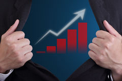 Businessman open suit to show growing graph Stock Photo