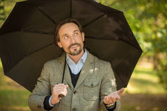 Businessman with opened umbrella Royalty Free Stock Image