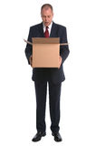 Businessman opening box Stock Image