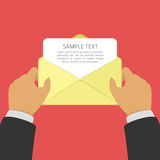 Businessman opening envelope with letter. Royalty Free Stock Image