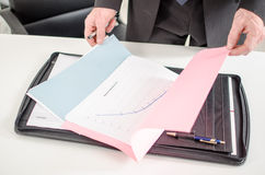 Businessman opening a folder Stock Photography