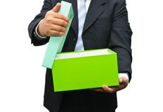 Businessman opening a gift box Royalty Free Stock Images