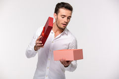 Businessman opening gift box Stock Photography