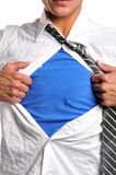 Businessman opening his shirt. Wearing a blue t-shirt undernith stock photo