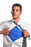 Businessman opening his shirt. Wearing a blue t-shirt underneath royalty free stock photos