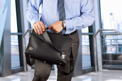 Businessman opening  a  leather briefcase Royalty Free Stock Photography