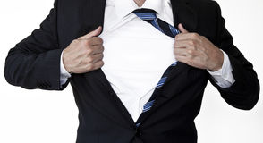 Businessman opening shirt Stock Photo