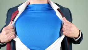 Businessman opening shirt in superhero style Stock Images