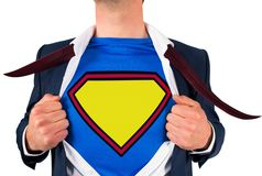 Businessman opening shirt in superhero style Royalty Free Stock Image