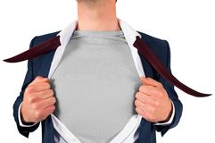 Businessman opening shirt in superhero style Stock Photos
