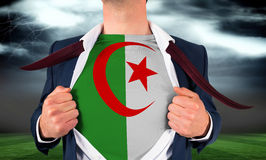 Businessman opening shirt to reveal algeria flag Stock Photography