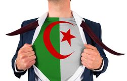 Businessman opening shirt to reveal algeria flag Royalty Free Stock Images