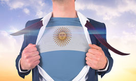 Businessman opening shirt to reveal argentina flag Royalty Free Stock Image