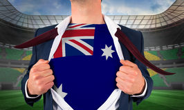 Businessman opening shirt to reveal australia flag Royalty Free Stock Photos