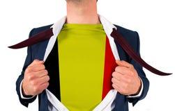 Businessman opening shirt to reveal belgium flag Stock Photography