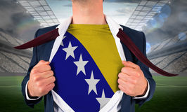 Businessman opening shirt to reveal bosnia flag Stock Images