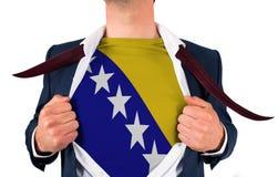 Businessman opening shirt to reveal bosnia flag Stock Photos