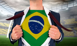 Businessman opening shirt to reveal brasil flag Stock Photography