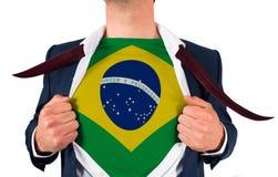 Businessman opening shirt to reveal brasil flag Stock Images