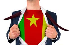 Businessman opening shirt to reveal cameroon flag Stock Photo