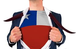 Businessman opening shirt to reveal chile flag Stock Photo
