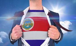 Businessman opening shirt to reveal costa rica flag Stock Photography