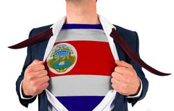 Businessman opening shirt to reveal costa rica flag Royalty Free Stock Images
