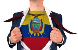 Businessman opening shirt to reveal ecuador flag Royalty Free Stock Photography