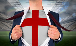 Businessman opening shirt to reveal england flag Royalty Free Stock Images