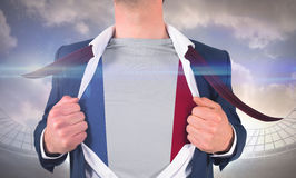 Businessman opening shirt to reveal france flag Royalty Free Stock Photo