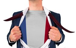 Businessman opening shirt to reveal france flag Royalty Free Stock Photos