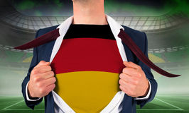 Businessman opening shirt to reveal germany flag Stock Photography