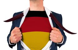 Businessman opening shirt to reveal germany flag Royalty Free Stock Photography