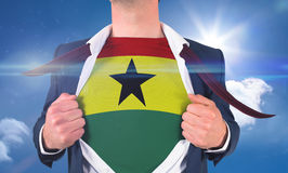 Businessman opening shirt to reveal ghana flag Stock Photos