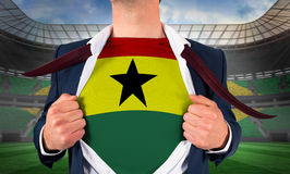 Businessman opening shirt to reveal ghana flag Royalty Free Stock Photo