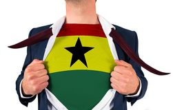 Businessman opening shirt to reveal ghana flag Royalty Free Stock Photography