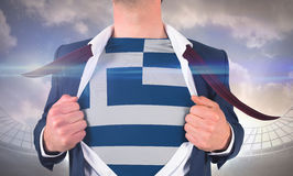 Businessman opening shirt to reveal greece flag Royalty Free Stock Image