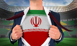 Businessman opening shirt to reveal iran flag Royalty Free Stock Photo