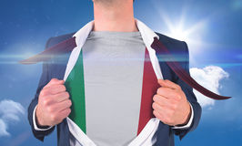 Businessman opening shirt to reveal italy flag Stock Photography