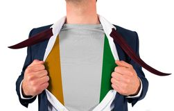 Businessman opening shirt to reveal ivory coast flag Stock Photos