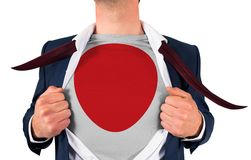Businessman opening shirt to reveal japan flag Royalty Free Stock Image