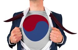 Businessman opening shirt to reveal korea republic flag Stock Image