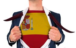 Businessman opening shirt to reveal spain flag Stock Photo