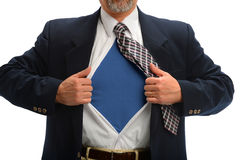 Businessman Opening Shirt to Reveal Super Hero Costume. Torso of businessman opening shirt to reveal super hero costume stock photography