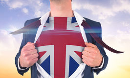 Businessman opening shirt to reveal union jack flag Stock Image