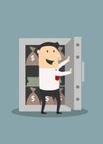 Businessman opens safe with money stacks and bags Royalty Free Stock Photo